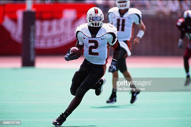 Willis McGahee of the Miami Hurricanes runs with the ball against the Temple Owls on September 14 2002
