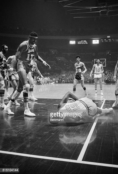 Willis Reed Down and Out New York Wilt Chamberlain Los Angeles Lakers' big man stands over his New York Knicks' counterpart as Willis Reed hits the...