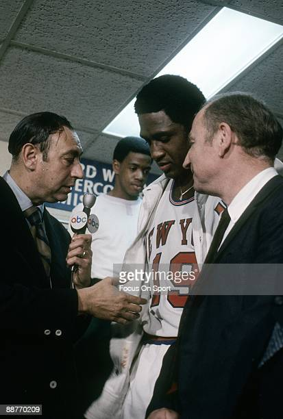 Willis Reed head coach Red Holzman of the New York Knickerbockers in the locker room is being interviewed by ABC's Howard Cosell after the Knicks...