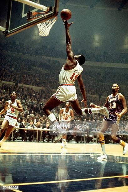 Willis Reed of the New York Knicks drives to the basket for a layup against the Los Angeles Lakers during an NBA game in 1970 at Madison Square...