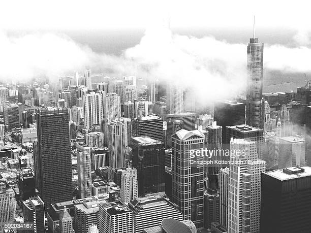 Willis Tower Amidst Buildings Against Cloudy Sky