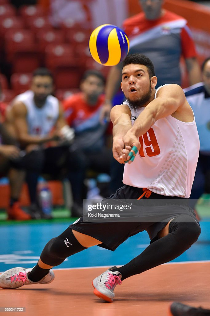 Willner Enrique Rivas Quijada #19 of Venezuela receives the ball during the Men's World Olympic Qualification game between Venezuela and Canada at Tokyo Metropolitan Gymnasium on June 1, 2016 in Tokyo, Japan.