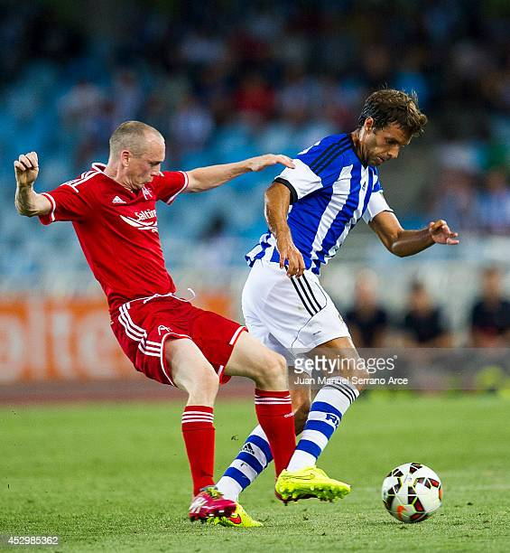 Willo Flood of Aberdeen CF duels for the ball with Xabi Prieto of Real Sociedad during the UEFA Europa League third round qualifying first leg match...