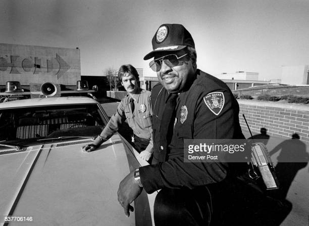 Willoughby Mercer dark uniform director of public safety at Red Rocks Campus Community College with officer Kevin Eldridge The two are twothirds of...