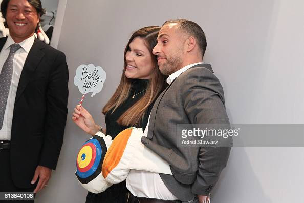 Willow Padilla and guest pose for a photo booth as Sara Blakely and Alice Olivia celebrate the launch of 'The Belly Art Project' on October 10 2016...