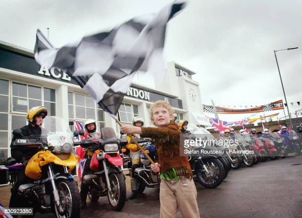 Willow Sanders son of round the world motorcycle race organiser Nick Sanders waves off competitors in the first ever roundtheworld motorcycle race at...