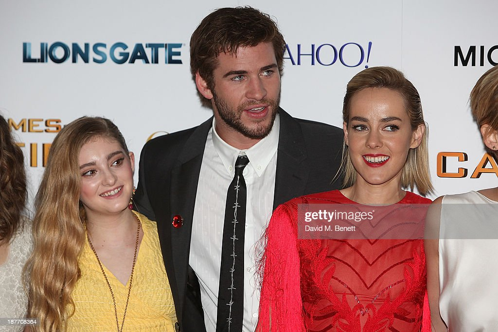Willow Shield, Liam Hemsworth and Jena Malone attend the UK Premiere of 'The Hunger Games: Catching Fire' at Odeon Leicester Square on November 11, 2013 in London, England.