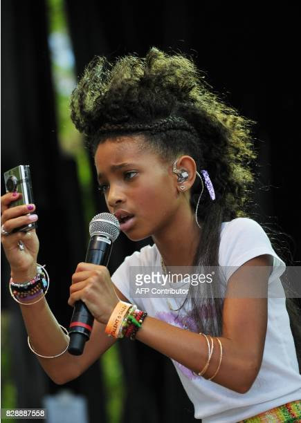 Willow Smith the daughter of actors Will Smith and Jada Pinkett Smith uses a camera while performing at the annual Easter egg roll April 25 2011 on...