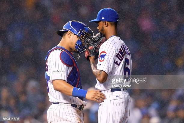 Willson Contreras and Carl Edwards Jr #6 of the Chicago Cubs meet in the eighth inning during game four of the National League Division Series...