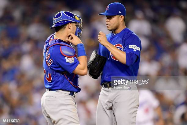 Willson Contreras and Jose Quintana of the Chicago Cubs talk on the mound against the Los Angeles Dodgers during the fifth inning in Game One of the...