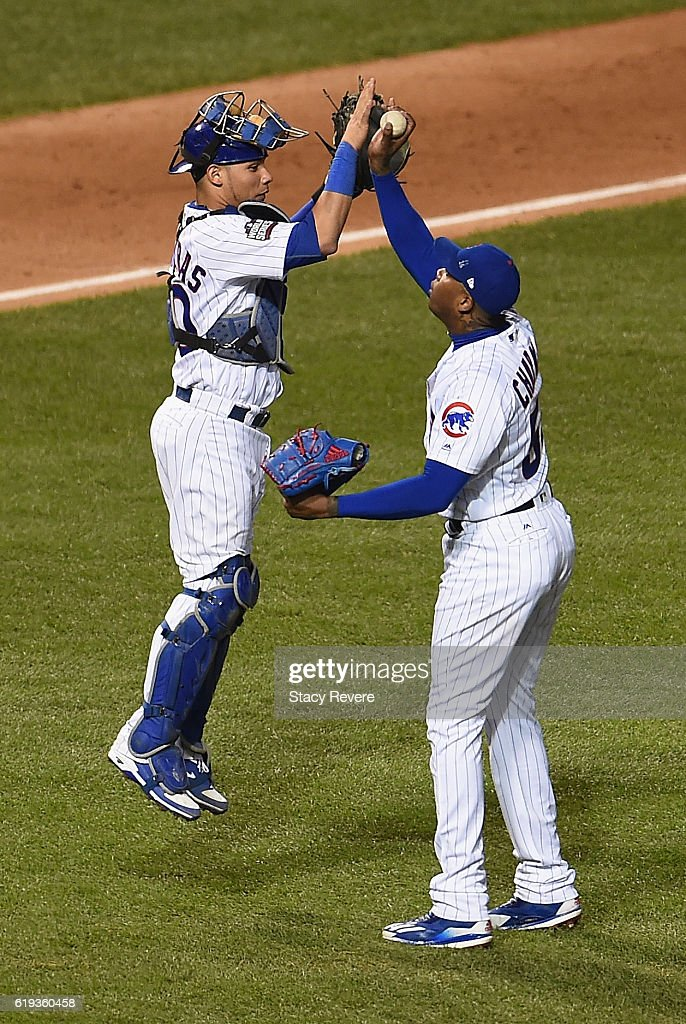 Willson Contreras #40 of the Chicago Cubs (L) and Aroldis Chapman #54 celebrate after beating the Cleveland Indians 3-2 in Game Five of the 2016 World Series at Wrigley Field on October 30, 2016 in Chicago, Illinois.