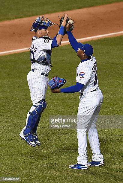 Willson Contreras of the Chicago Cubs and Aroldis Chapman celebrate after beating the Cleveland Indians 32 in Game Five of the 2016 World Series at...