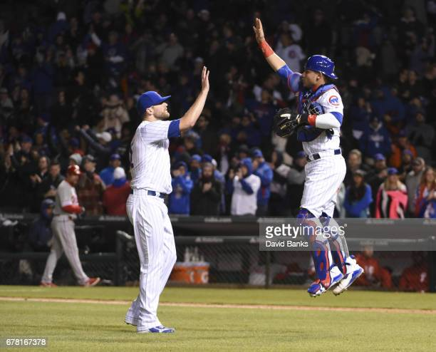 Willson Contreras of the Chicago Cubs and Wade Davis celebrate their win against the Philadelphia Phillies on May 3 2017 at Wrigley Field in Chicago...