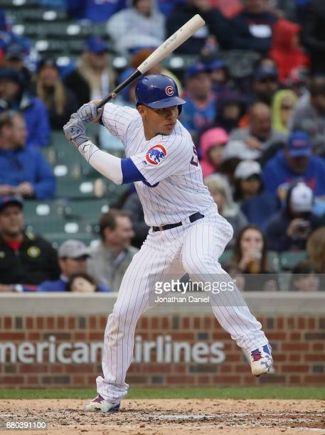 Willson Contreras of the Chicago Cubs bats against the Milwaukee Brewers at Wrigley Field on April 19 2017 in Chicago Illinois The Cubs defeated the...