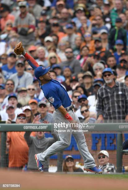 Willson Contreras of the Chicago Cubs catches a foul popup off the bat of Pablo Sandoval of the San Francisco Giants in the bottom of the fifth...