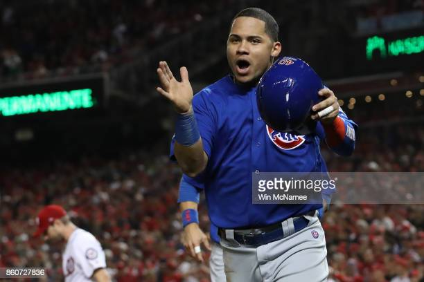 Willson Contreras of the Chicago Cubs celebrates after a double hit by Addison Russell of the Chicago Cubs against the Washington Nationals during...