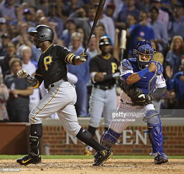 Willson Contreras of the Chicago Cubs celebrates after Andrew McCutchen of the Pittsburgh Pirates stirkes out with the bases loaded to end the top...