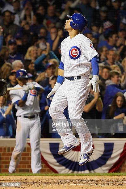 Willson Contreras of the Chicago Cubs celebrates after hitting a solo home run in the fourth inning against the Los Angeles Dodgers during game six...