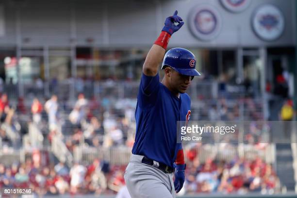 Willson Contreras of the Chicago Cubs celebrates after hitting a solo home run against the Washington Nationals in the first inning at Nationals Park...