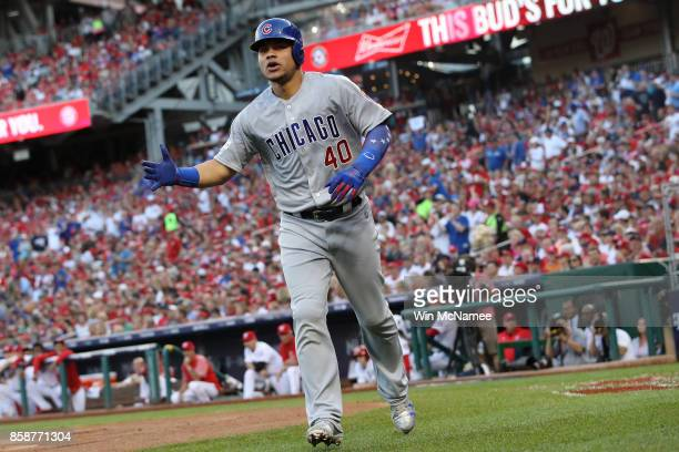 Willson Contreras of the Chicago Cubs celebrates after hitting a solo home run against the Washington Nationals in the first inning during game two...