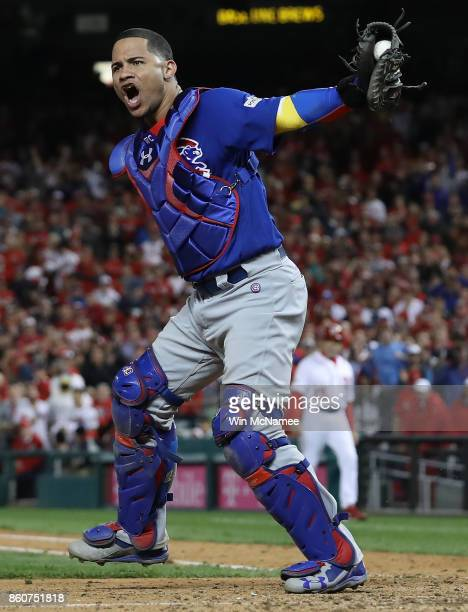 Willson Contreras of the Chicago Cubs celebrates after the final out of Game 5 of the National League Divisional Series at Nationals Park on October...