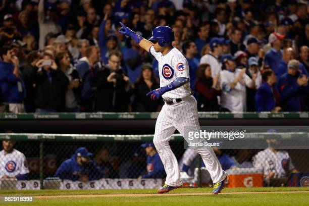 Willson Contreras of the Chicago Cubs celebrates as he rounds the bases after hitting a home run in the second inning against the Los Angeles Dodgers...