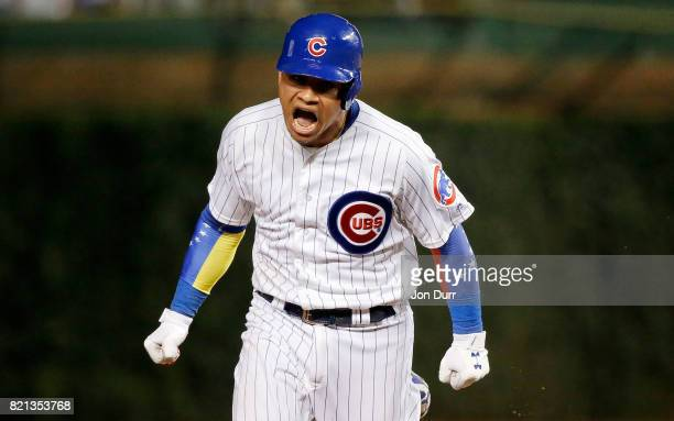 Willson Contreras of the Chicago Cubs celebrates his tw run home run against the St Louis Cardinals during the sixth inning at Wrigley Field on July...