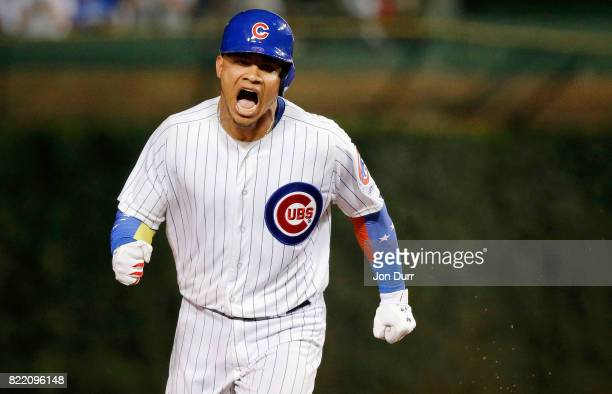 Willson Contreras of the Chicago Cubs celebrates his two run home run against the St Louis Cardinals during the sixth inning at Wrigley Field on July...