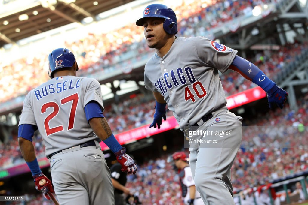 Willson Contreras #40 of the Chicago Cubs celebrates with Addison Russell #27 of the Chicago Cubs after hitting a solo home run against the Washington Nationals in the first inning during game two of the National League Division Series at Nationals Park on October 7, 2017 in Washington, DC.