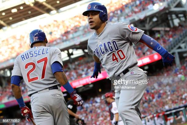 Willson Contreras of the Chicago Cubs celebrates with Addison Russell of the Chicago Cubs after hitting a solo home run against the Washington...