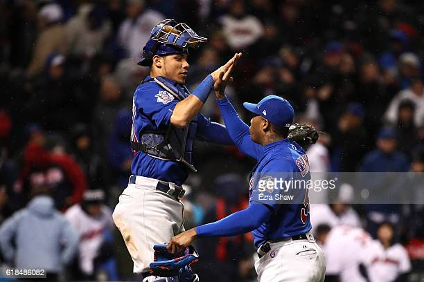Willson Contreras of the Chicago Cubs celebrates with Aroldis Chapman after defeating the Cleveland Indians 51 in Game Two of the 2016 World Series...