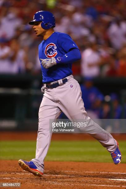 Willson Contreras of the Chicago Cubs crosses home plate after hitting his second home run of the game against the St Louis Cardinals in the fourth...