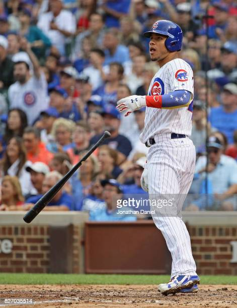 Willson Contreras of the Chicago Cubs drops his bat as he follows the flight of his solo home run in the 3rd inning against the Washington Nationals...