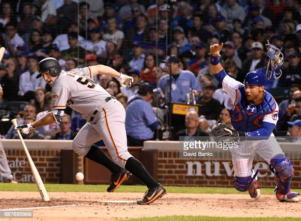 Willson Contreras of the Chicago Cubs fields a bunt hit by Ty Blach of the San Francisco Giants on May 22 2017 at Wrigley Field in Chicago...