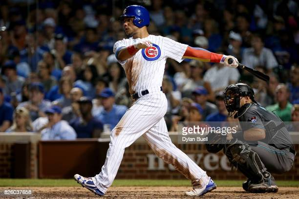 Willson Contreras of the Chicago Cubs hits a double in the sixth inning against the Arizona Diamondbacks at Wrigley Field on August 1 2017 in Chicago...