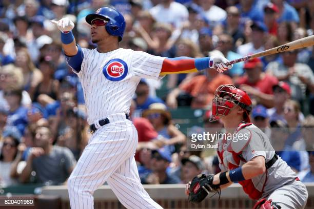 Willson Contreras of the Chicago Cubs hits a home run in the first inning against the St Louis Cardinals at Wrigley Field on July 21 2017 in Chicago...
