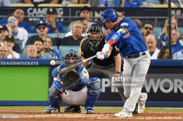 Willson Contreras of the Chicago Cubs hits a single against Clayton Kershaw of the Los Angeles Dodgers during the fourth inning in Game One of the...