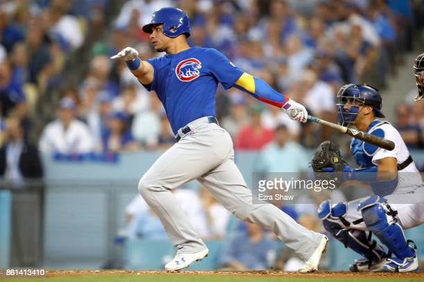 Willson Contreras of the Chicago Cubs hits a single during the fourth inning of Game One of the National League Championship Series at Dodger Stadium...