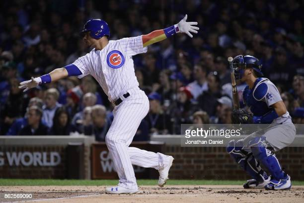 Willson Contreras of the Chicago Cubs hits a single in the first inning against the Los Angeles Dodgers during game three of the National League...