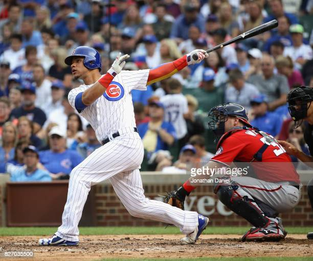 Willson Contreras of the Chicago Cubs hits a solo home run in the 3rd inning against the Washington Nationals at Wrigley Field on August 6 2017 in...