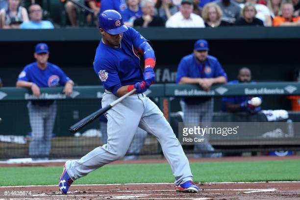 Willson Contreras of the Chicago Cubs hits a three run home run against the Baltimore Orioles in the first inning at Oriole Park at Camden Yards on...