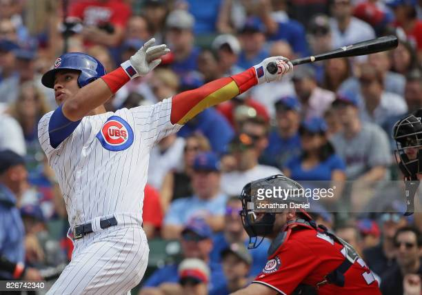 Willson Contreras of the Chicago Cubs hits a two run home run in the 6th inning against the Washington Nationals at Wrigley Field on August 5 2017 in...