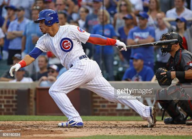 Willson Contreras of the Chicago Cubs hits a two run single in the 7th inning against the Arizona Diamondbacks at Wrigley Field on August 3 2017 in...