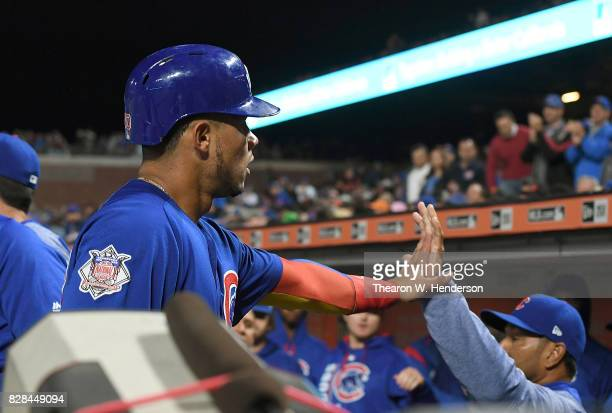 Willson Contreras of the Chicago Cubs in scongratulated by teammates after Contreras scord against the San Francisco Giants in the top of the six...
