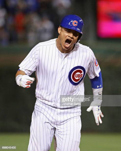 Willson Contreras of the Chicago Cubs is celebrates as he runs the bases after hitting a solo home run in the 7th inning against the San Diego Padres...