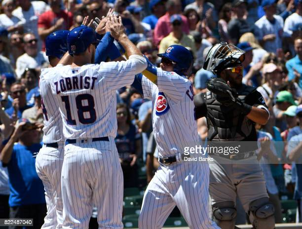 Willson Contreras of the Chicago Cubs is greeted by Ben Zobrist and Anthony Rizzo after hitting threerun homer against the Chicago White Sox during...