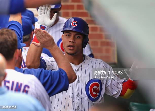 Willson Contreras of the Chicago Cubs is greeted in the dugout after hitting a two run home run in the 6th inning against the Washington Nationals at...