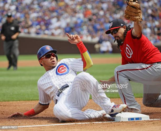 Willson Contreras of the Chicago Cubs is tagged out at third base by Anthony Rendon of the Washington Nationals in the 1st inning at Wrigley Field on...