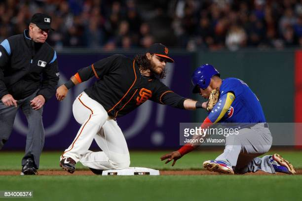 Willson Contreras of the Chicago Cubs is tagged out attempting to steal second base by Brandon Crawford of the San Francisco Giants in front of...
