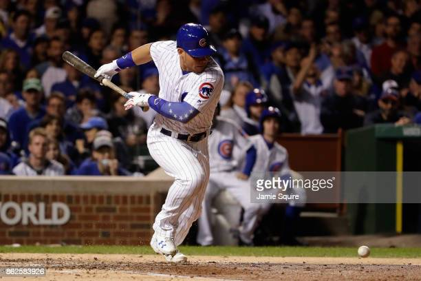 Willson Contreras of the Chicago Cubs lays down a bunt in the fourth inning against the Los Angeles Dodgers during game three of the National League...